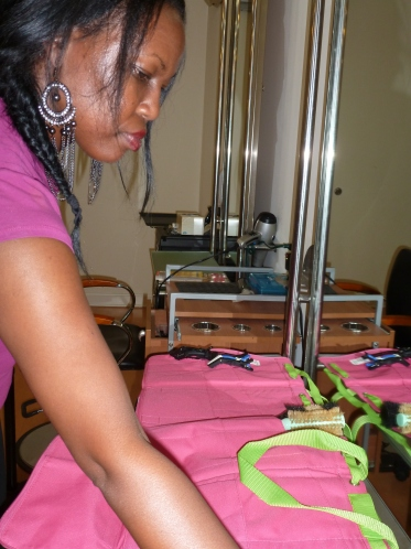 Jacquetta getting ready to set up a Nantucket Bagg to travel to weddings.